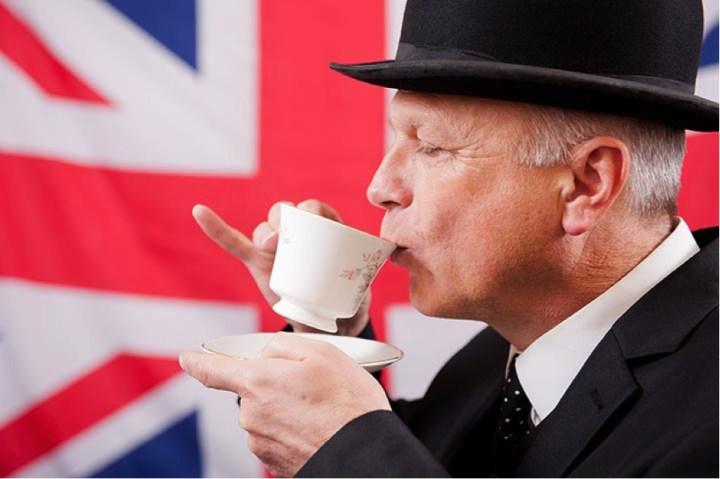 british man drinking tea