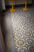 The floors were hand-stamped by Davol's wife. | Photo Credit: Ruben Karel