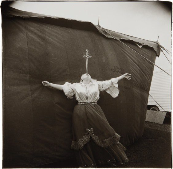 Copyright © The Estate of Diane Arbus, Albino sword swallower at a carnival, Md., 1970