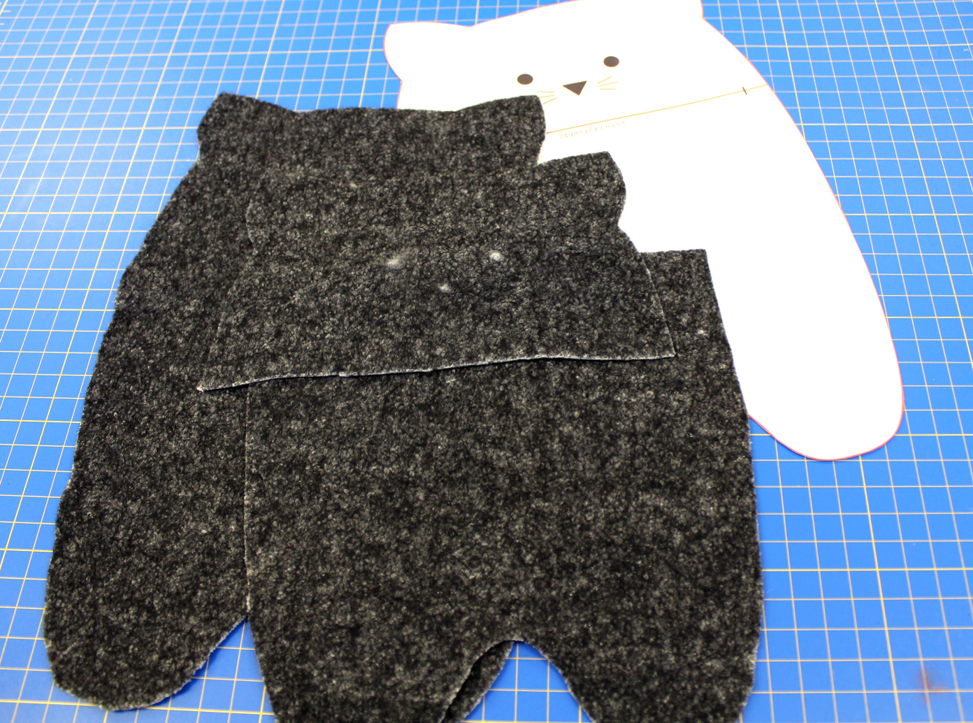 photo of the kitty case pattern cut out in boiled wool