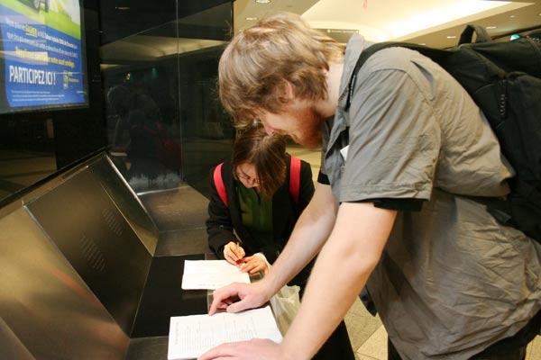 Kristin Donovan and Alex Dowgailenko check their lists