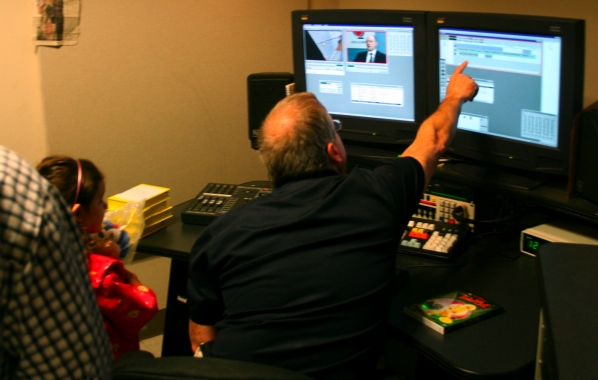 An editor shows a future journalist how stories are put together