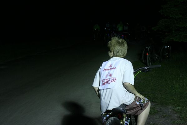 The route took cyclists through the St. Michel environment complex, where portable lights on generators showed cyclists the way.
