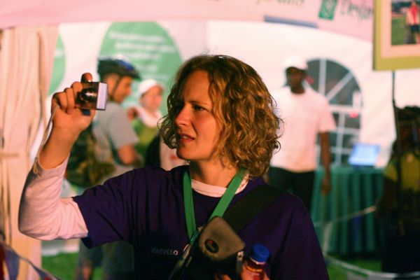 A volunteer takes photos of the event.