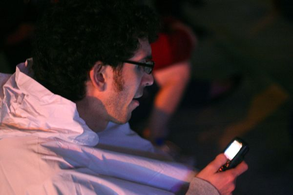 Some bozo plays with his cellphone instead of watching the concert