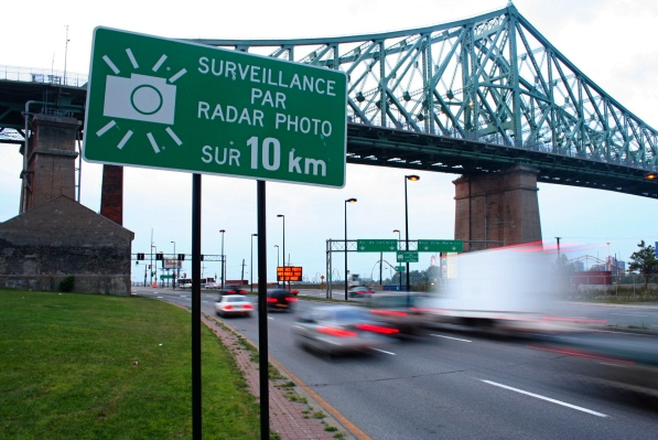 Giant signs warn motorists about secret photo radar cash grab