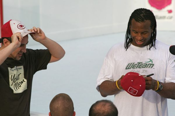 Laraque signs a cap for an excited fan