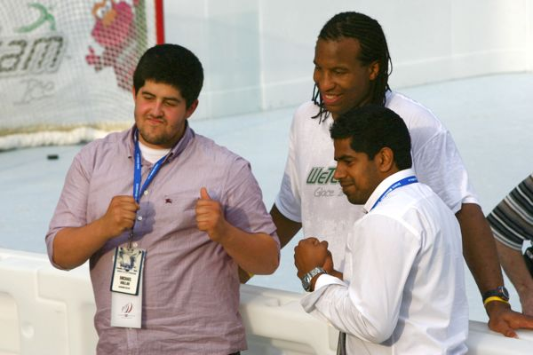 Georges Laraque and two fans pose boxing-weigh-in-style