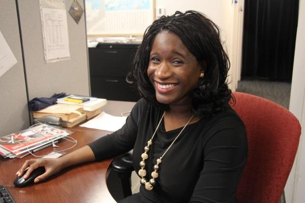 Elysia Bryan-Baynes at her newsroom desk at Global Montreal