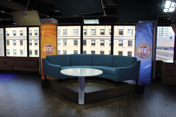 A couch in the centre of the studio provides space for interviews and discussions.