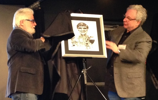 George Balcan drawing unveiled by Terry Mosher, left, and Bill Brownstein