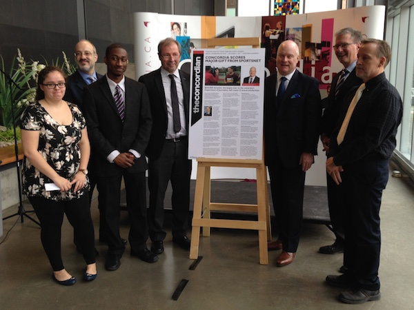 Students and staff at Concordia celebrate their donation with Sportsnet president Scott Moore (third from left).