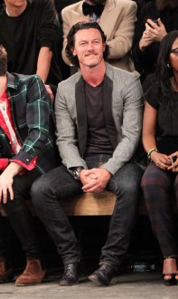 LONDON, ENGLAND - JANUARY 07: Luke Evans (C) sits in the front row during the Superdry AW14 catwalk event as part of London Collections: Men at The Old Sorting Office on January 7, 2014 in London, England. (Photo by David M. Benett/Getty Images for Superdry) *** Local Caption *** Luke Evans