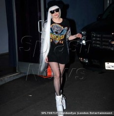 EXCLUSIVE: Lady Gaga wears a very large pair of platform shoes and a platinum blonde wig as she leaves a studio in Hollywood, CA