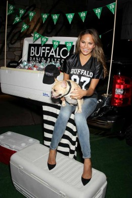 "Chrissy Teigen hosts a Buffalo David Bitton ""tailgate party"" for the Jets/Patriots game at Lord & Taylor"
