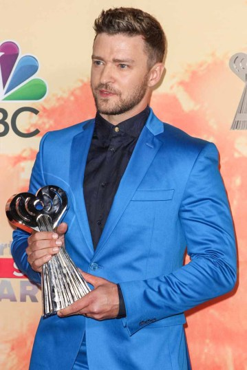 Justin Timberlake poses in the press room at the iHeartRadio Awards