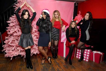 NEW YORK, NY - DECEMBER 10: (L-R) Camila Cabello, Normani Kordei, Dinah Jane, Ally Brooke Hernandez and Lauren Jauregui of Fifth Harmony pose at The Candie's Winter Bash on December 10, 2015 in New York City. (Photo by Cindy Ord/Getty Images for Candie's)