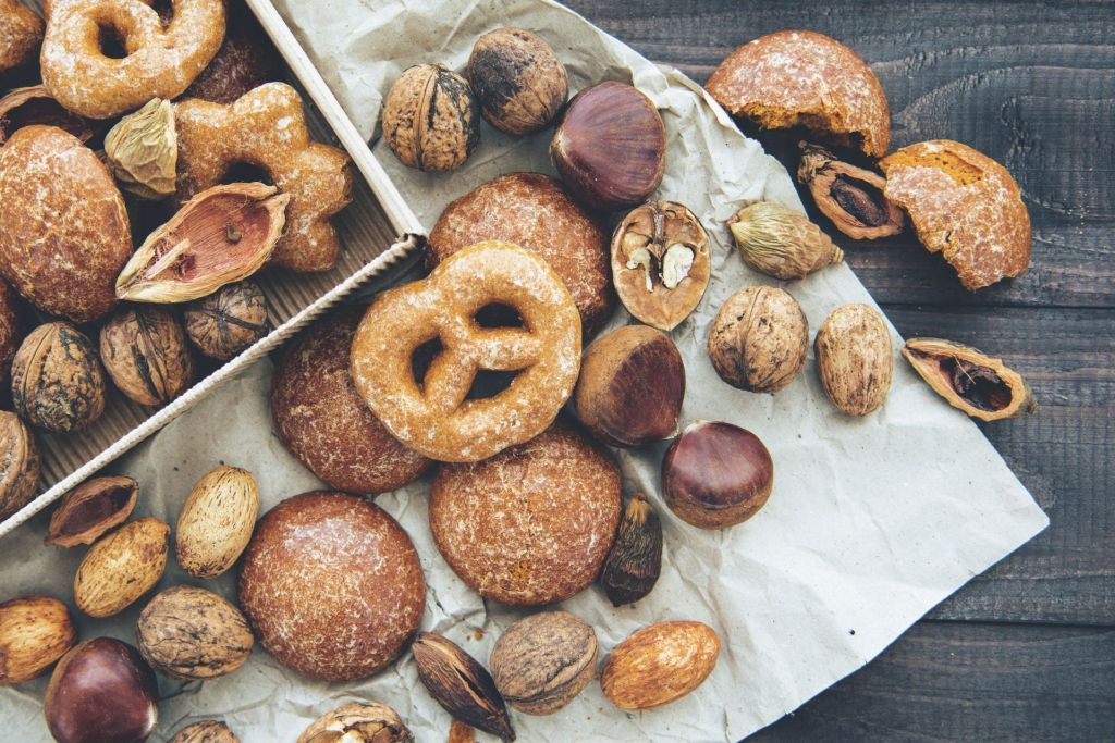 Overflowing box of pretzels, bread, and pastries for snack