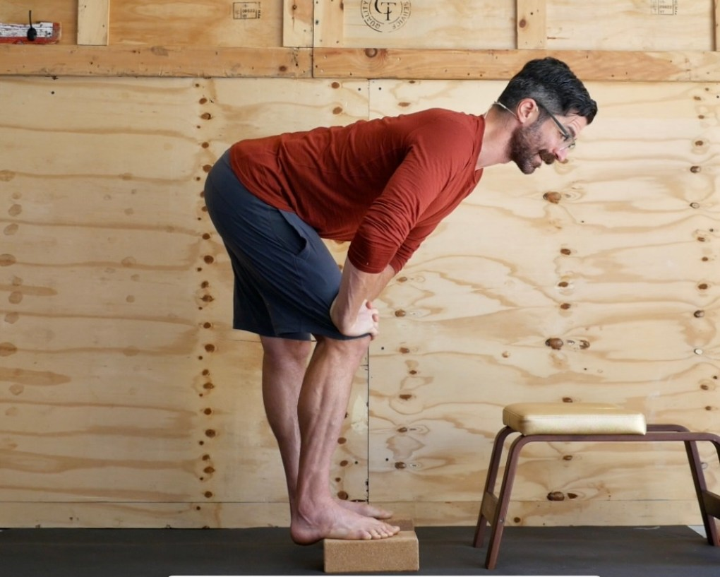 Use this Yoga Brick Standing Leg Balance Stretch for Better Forward Folds