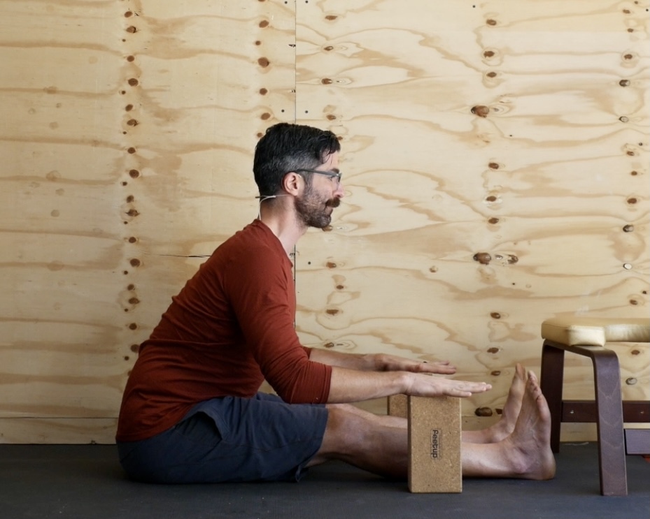 Supported Forward Fold with Yoga Brick