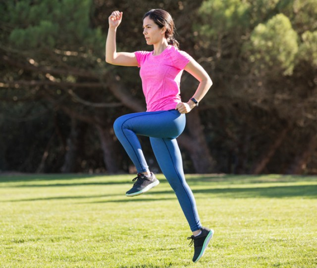 Woman Skipping To Warm Up Before Exercise