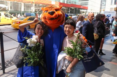 Stitch the tiger with two graduates