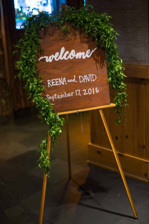 Flora Nova Design Seattle - Colorful Indian Wedding at the Edgewater Hotel. Welcome Sign with Smilax Greenery Garland