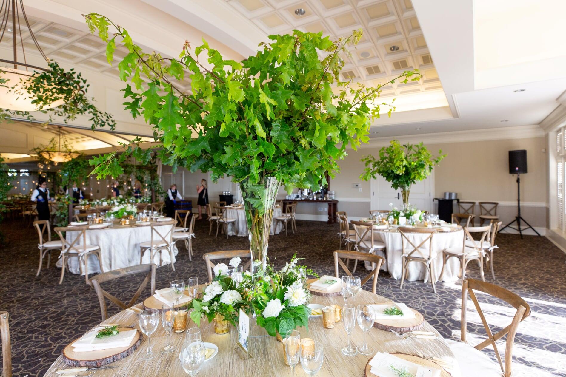 Tall greenery wedding centerpiece