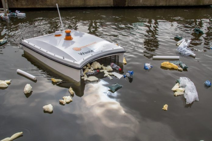 trash eating drone collects waste from a polluted water body