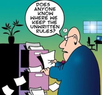 Does Anyone Know Where We Keep the Unwritten Rules cartoon. Man shuffling papers from a file cabinet.