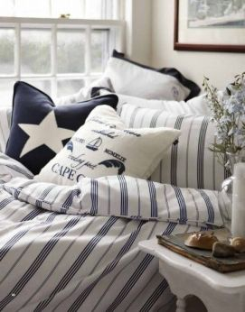 Stripes, navy blue and illustrated pillows