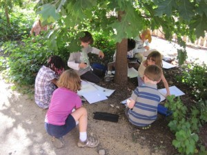 Kindergartners sketching outside
