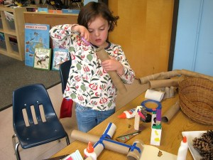 Students practice construction and crafting skills like cutting, glueing and painting during project time.