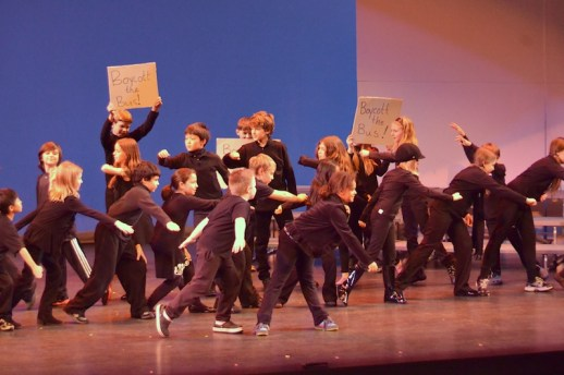 third and fourth graders perform a dance