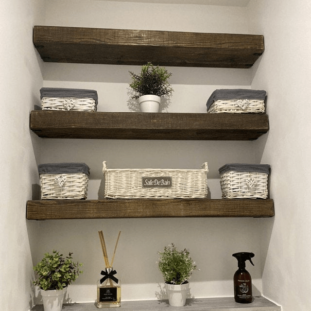 set of three rustic chunky floating shelves in a toilet