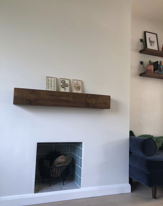 white fireplace wall with small tiled hearth and solid oak mantel shelf