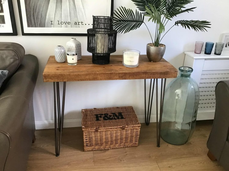 Bowes console table with hairpin legs and three inch solid wood top in medium oak