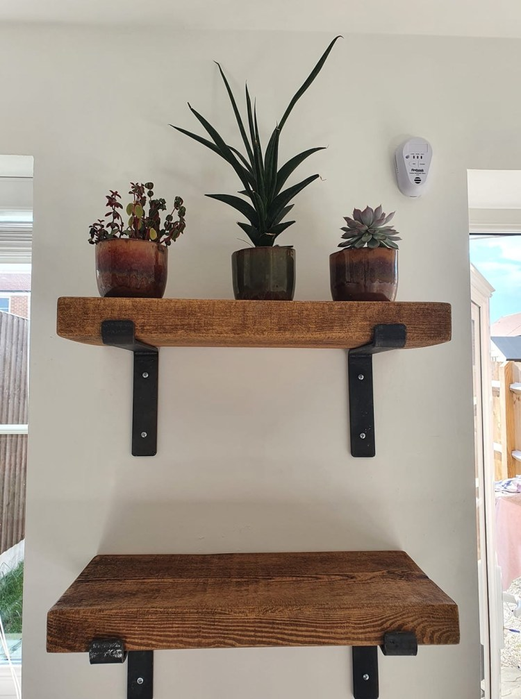 Hetton Bracket Shelves with medium oak solid wood shelves on a kitchen wall.