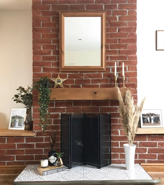 exposed brickwork fireplace with chunky solid wood mantel