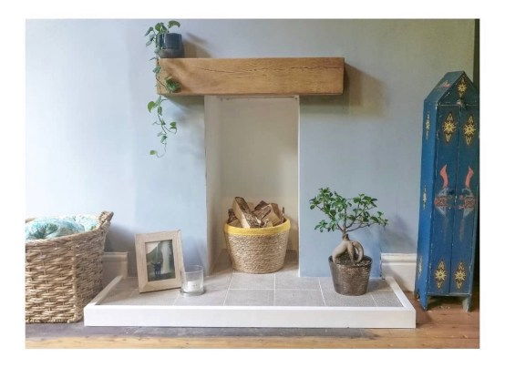 Chunky oak mantel on light blue wall in a Leeds terrace