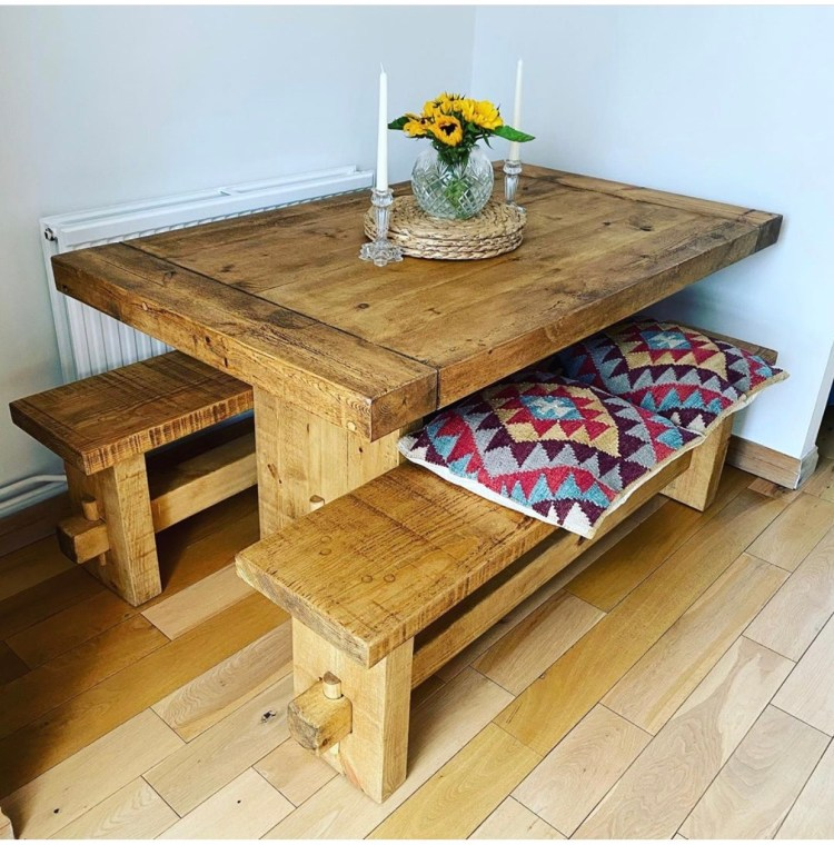 solid wood dining table and benches in kitchen