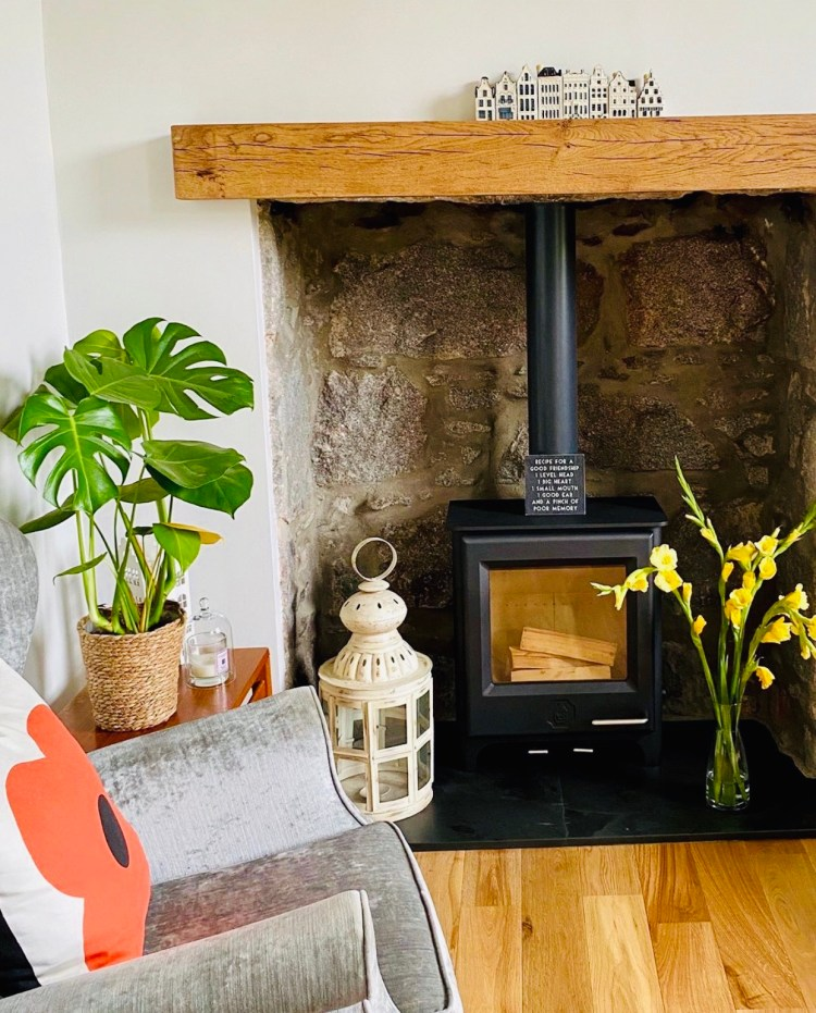 oak floating mantel above wood burner stove