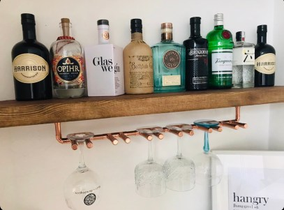 Copper Wine Glass Holder under Drinks Shelf.