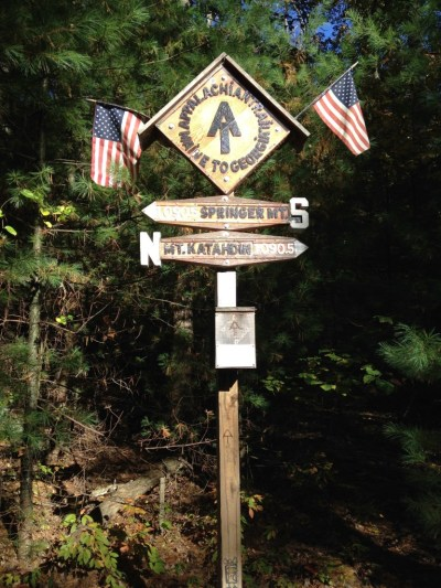 Gorgeous, hand-crafted wooden mid-point sign on the trail