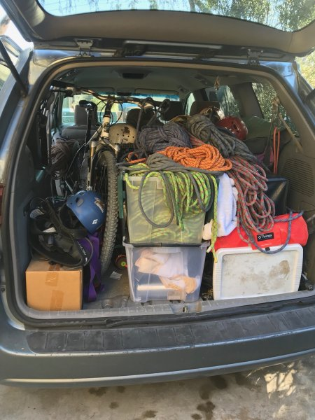 An open hatchback on a sport utility vehicle showing ropes and rescue gear inside.