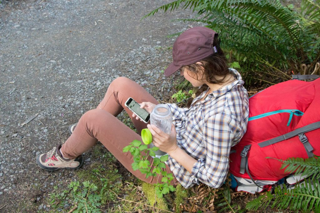 A backpacker looking at her phone
