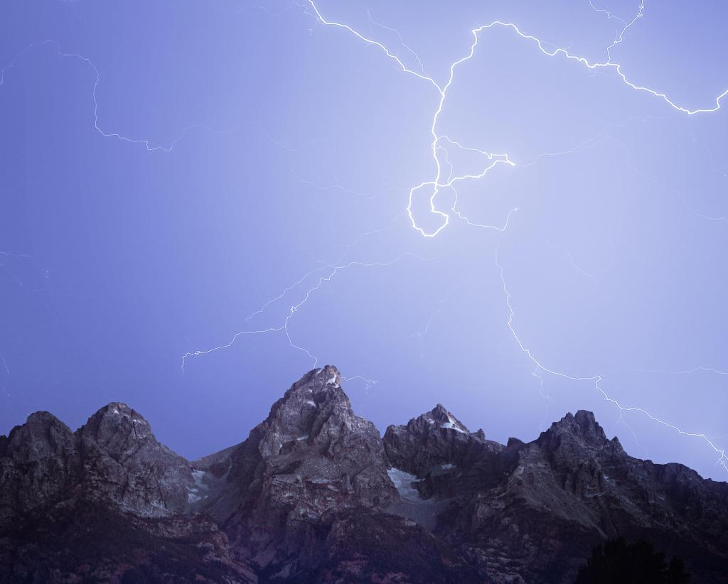 lightning striking over the Tetons in in Grand Teton National Park