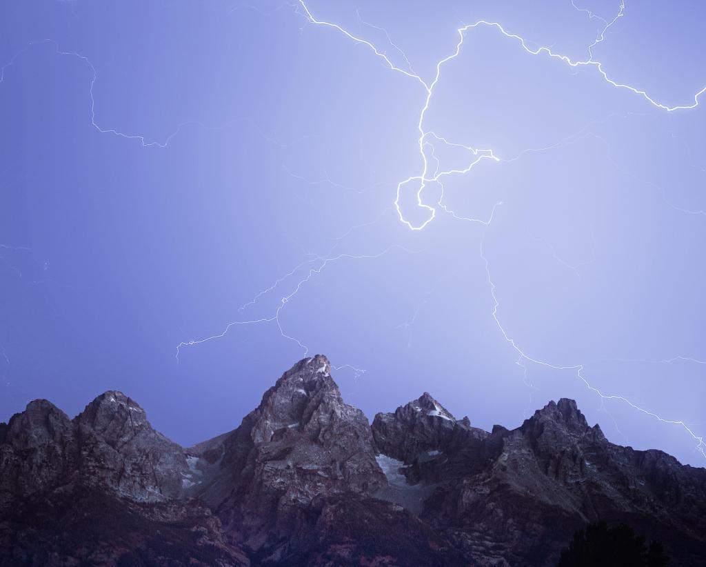 lightning striking over the Tetons in in Grand Teton National Park