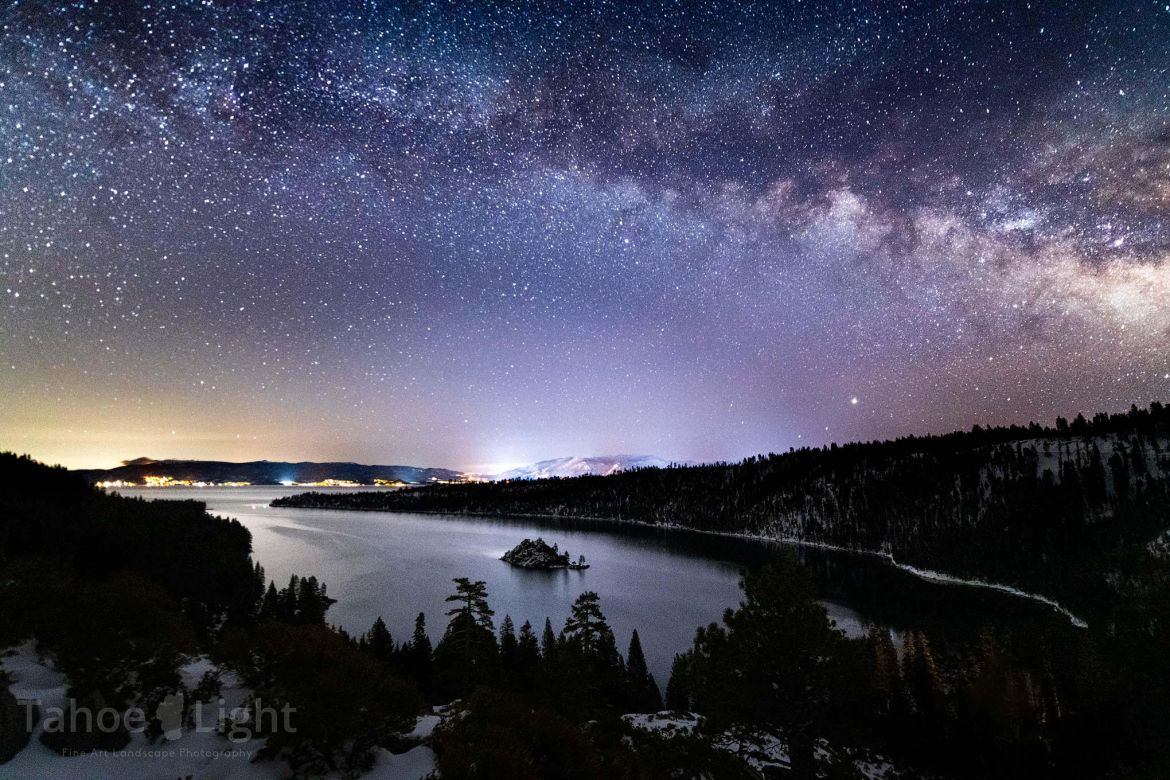 Lake Tahoe's Emerald Bay under a star-filled sky.