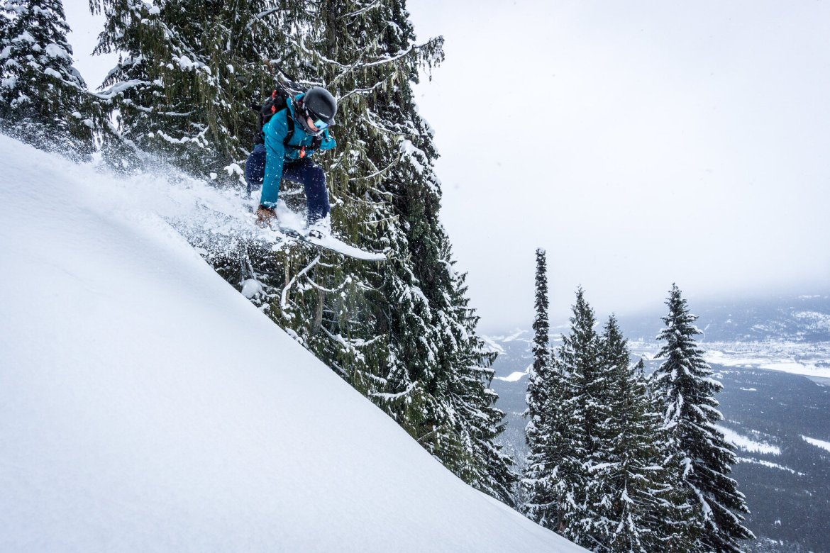 A snowboarder hits some air.